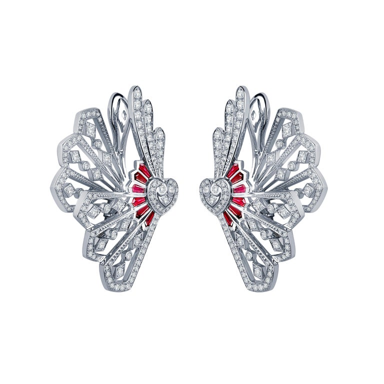 A pair of 18 karat white gold climber earrings from the House of Garrard Fanfare collection set with 236 round white diamonds weighing 1.80 carats and 12 calibre cut rubies weighing 0.78 carats.   236 round white diamonds weighing 1.80 carats 12