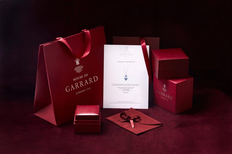 Women's or Men's Garrard 'Fanfare' White Gold White Diamond and Calibre Cut Ruby Ear Climbers  For Sale
