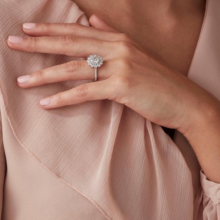 Modern Garrard 'Harmony' Platinum Round White Diamond GIA 3.22 Karat Engagement Ring For Sale