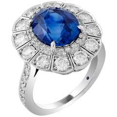 Garrard Platinum GRS 6.01 Carat Vivid Blue Oval Unheated Sapphire Cluster Ring