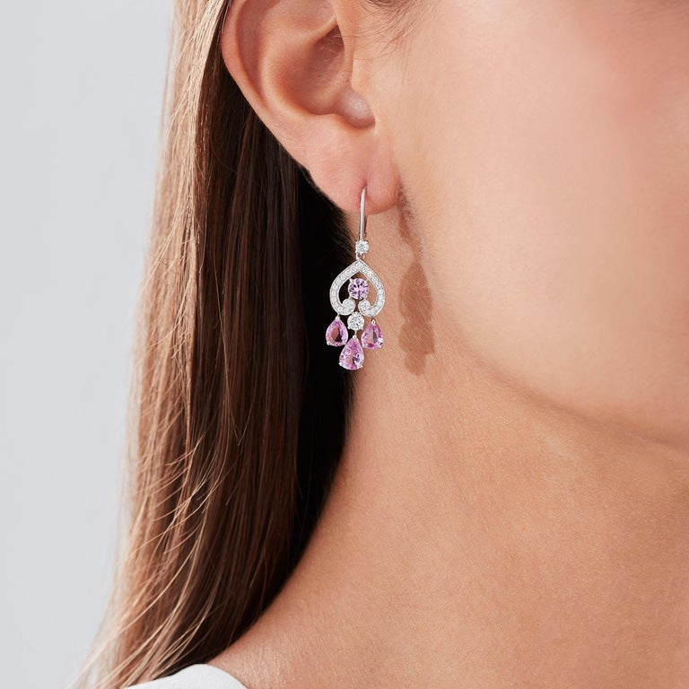 A House of Garrard pair of 18 karat white gold drop earrings from the 'Regal Cascade' collection, set with round white diamonds and round and pearshape pink sapphires.  50 round white diamonds weighing: 0.88cts 8 pink sapphires weighing: