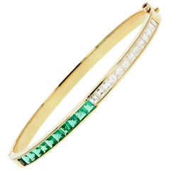 Garrard Yellow Gold Calibre Cut Natural Emerald and Square Cut Diamond Bangle