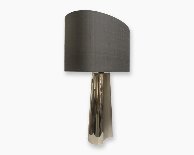Concave Table Lamp, 2015 The concave table lamp features a subtle geometric design depicted in forged 24 karat champagne gold-plated metal. The curved rounded motif draws its inspiration from the early 20th century Streamline Moderne style of