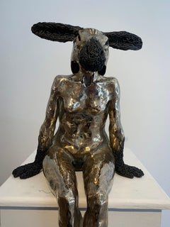 Sitting Woman with Removable Goat Mask