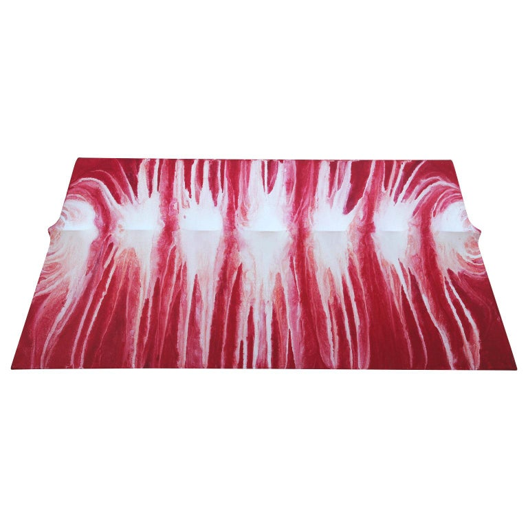 Red and white three-dimensional trapeze-shaped canvas. The artist creates each individual canvas shape and stretched the canvas over the uniquely created stretchers. Towards the top of the canvas is a ripple shape where the white is painting on the