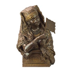 Polychrome and gilt bronze bust of a gypsy woman