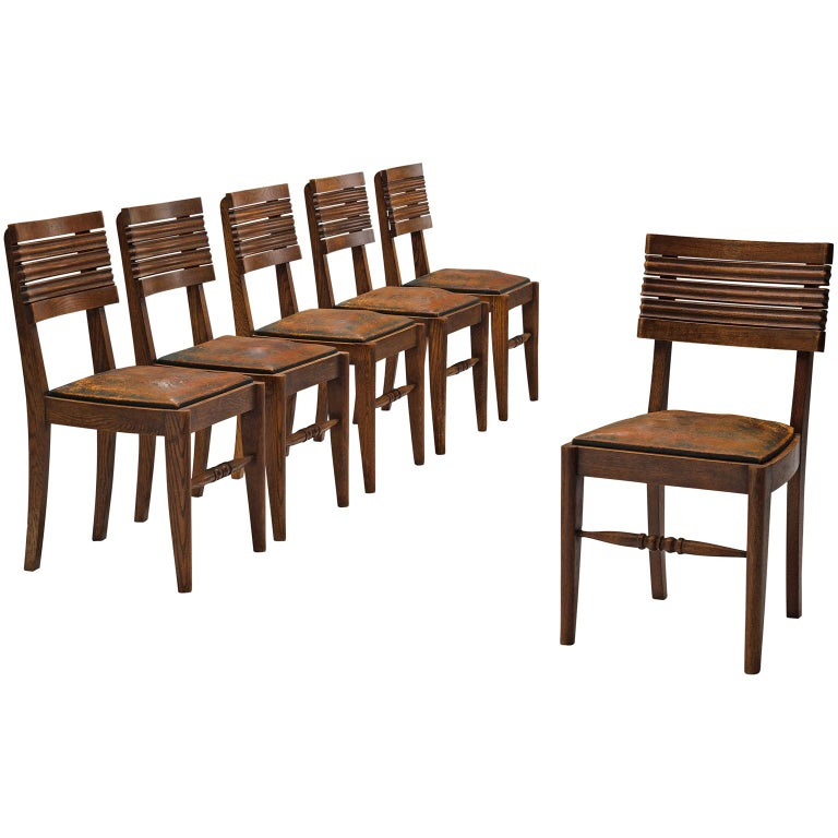 Gaston Poisson Set of Six Leather and Oak Dining Chairs For Sale