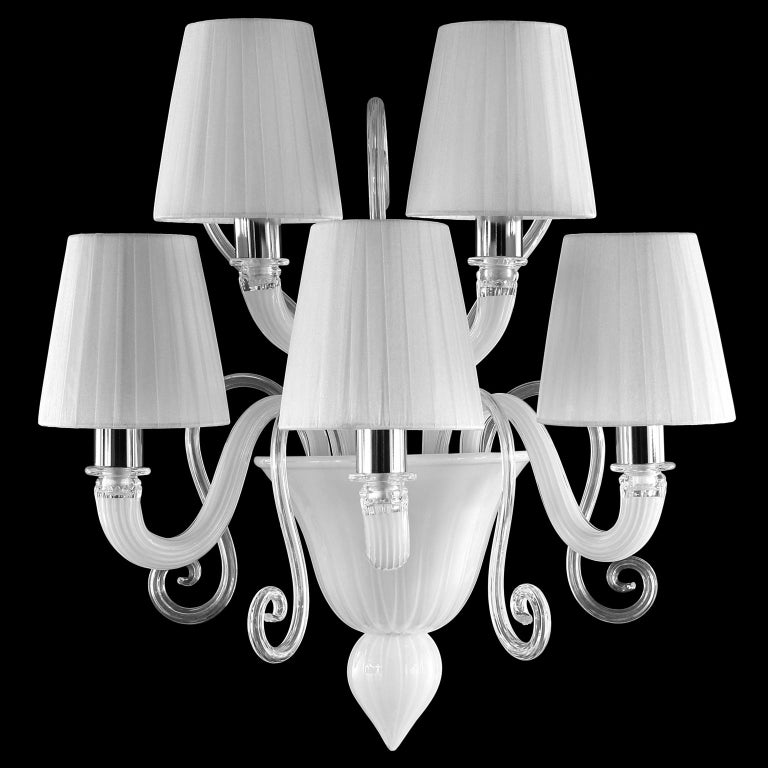 Gatsby wall 5-light, white encased Murano glass. 'Reversed' decorative curl elements. White handmade organza plissé lampshades The collection Gatsby is the perfect combination of elegant and modern elements. The use of colour featuring bright tones,