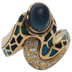 Gaudi Blue Topaz Oval Cabochon and White Diamond Ring in 18 Karat Yellow Gold