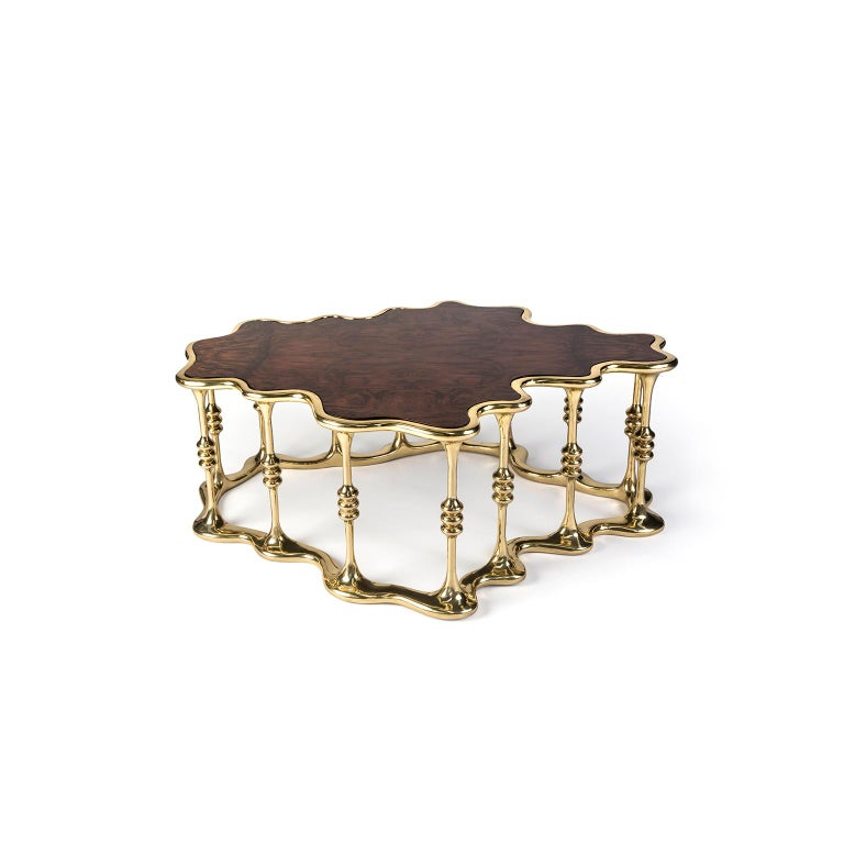 """1. Product description:  The """"Gaudi"""" center table is made of polished brass cast with a walnut root veneer tabletop complementing the set. After smelting, a process known for thousands of years widely used in brass and bronze sculptures and precious"""