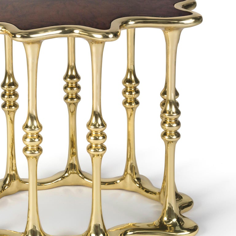 """1. Product description:  The """"Gaudi"""" side table is made of polished brass cast with a walnut root veneer tabletop complementing the set. After smelting, a process known for thousands of years widely used in brass and bronze sculptures and precious"""