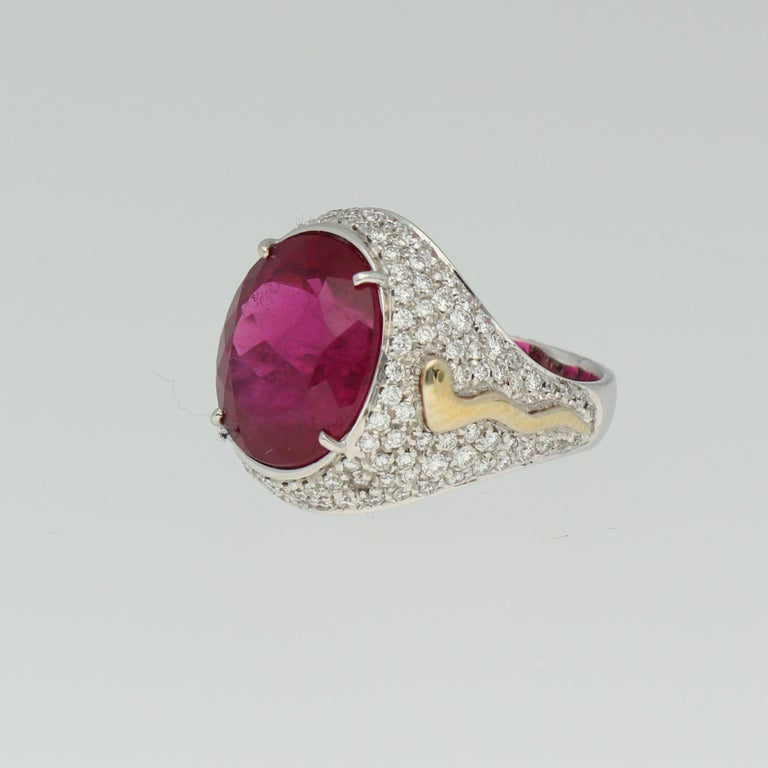 A Rubellite and pave  Diamonds mounted in an 18K White and Yellow Gold Cocktail Ring, belonging to the Desert collection.  Size METRIC 53 AMERICAN 6 3/4  Components: 18K white and yellow gold - 12.20 grams Total diamonds weight - 1.66 carats G / VS
