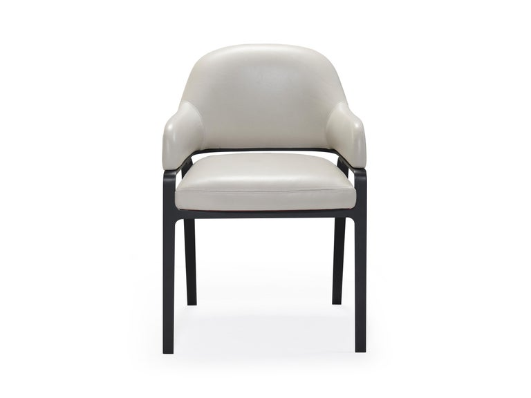 Gazelle dining chairs are both minimal and luxurious. A delicate metal framework raises the seat and wraps the back emphasizing the chairs dynamic stance. This timeless design with its energetic proportions echoes its graceful namesake animal.