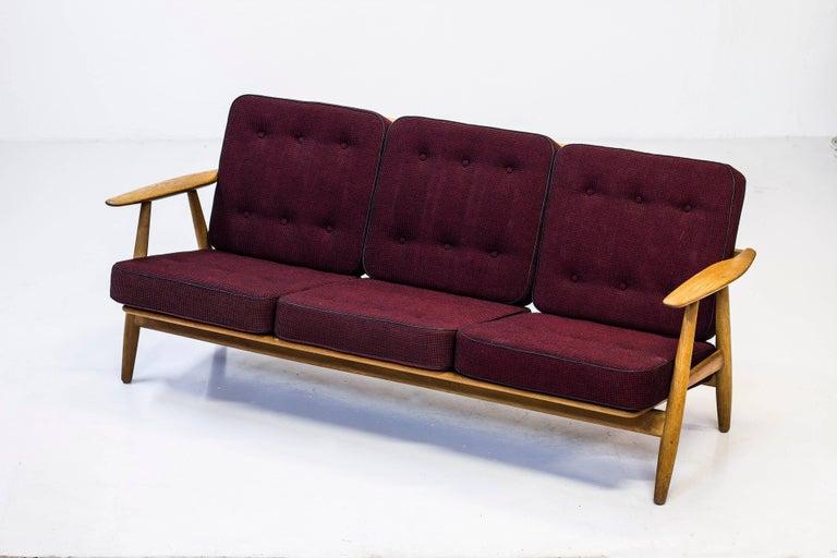 Three-seat sofa designed by Hans J. Wegner model