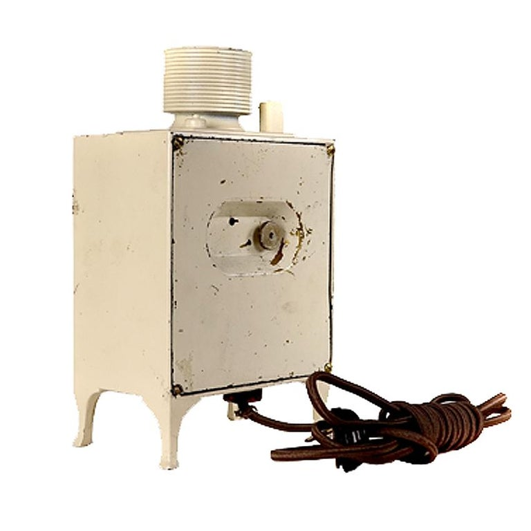 G. E. Refrigerator clock, called monitor top, were giveaways with the purchase of a GE refrigerator. Cast metal clock case is 8 3/4