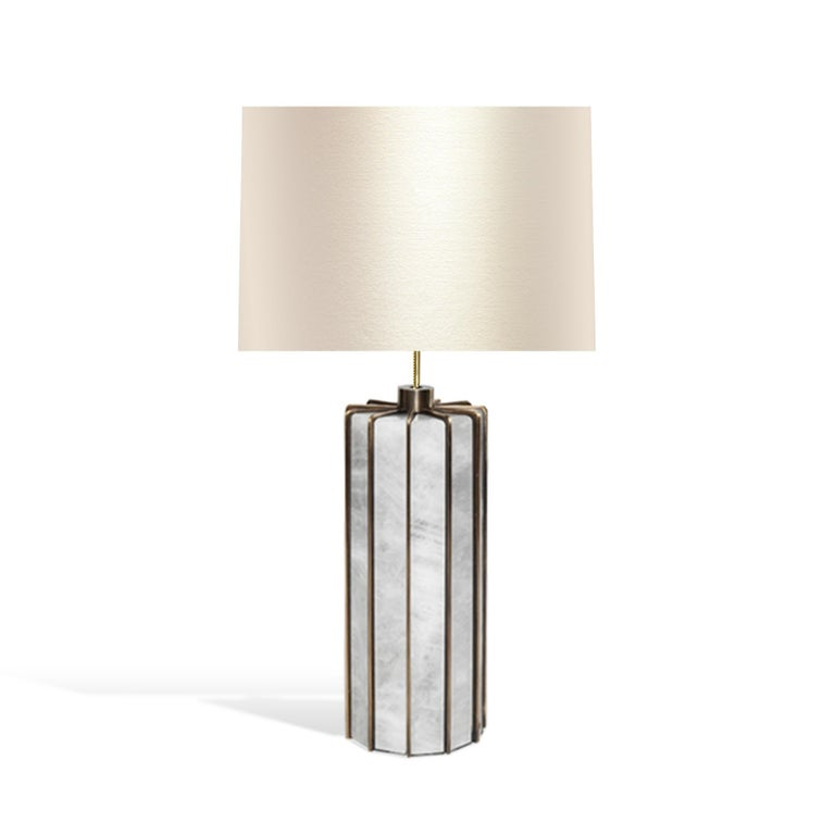 Pair of rock crystal lamps with antique brass stand. Created by Phoenix Gallery, NYC. Each lamp installed two sockets. To the top of the rock crystal: 12inch. Lampshade not included.custom size and finish upon request.