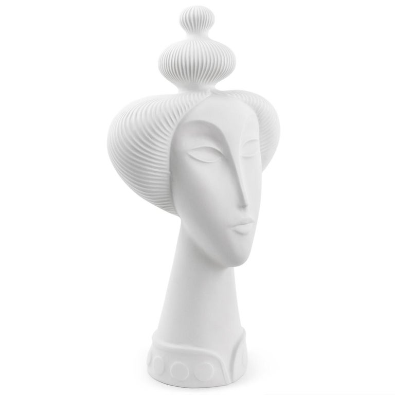 Bewitching visage. A whisper of Giacometti, a hint of Brancusi, a nod to Japan, and a heap of sculptural hair. Our matte unglazed porcelain Geisha Sculpture is dynamic from every angle—abstracted, elongated, elegant—and as much a formal exploration