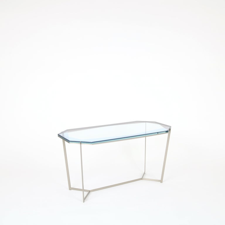 Inspired by the reflections of light and transparencies found in gemstones, these metal and glass tables translate facets through layers of color and varying opacity. Each tabletop color-way conveys the throw of light over a stone's surface by