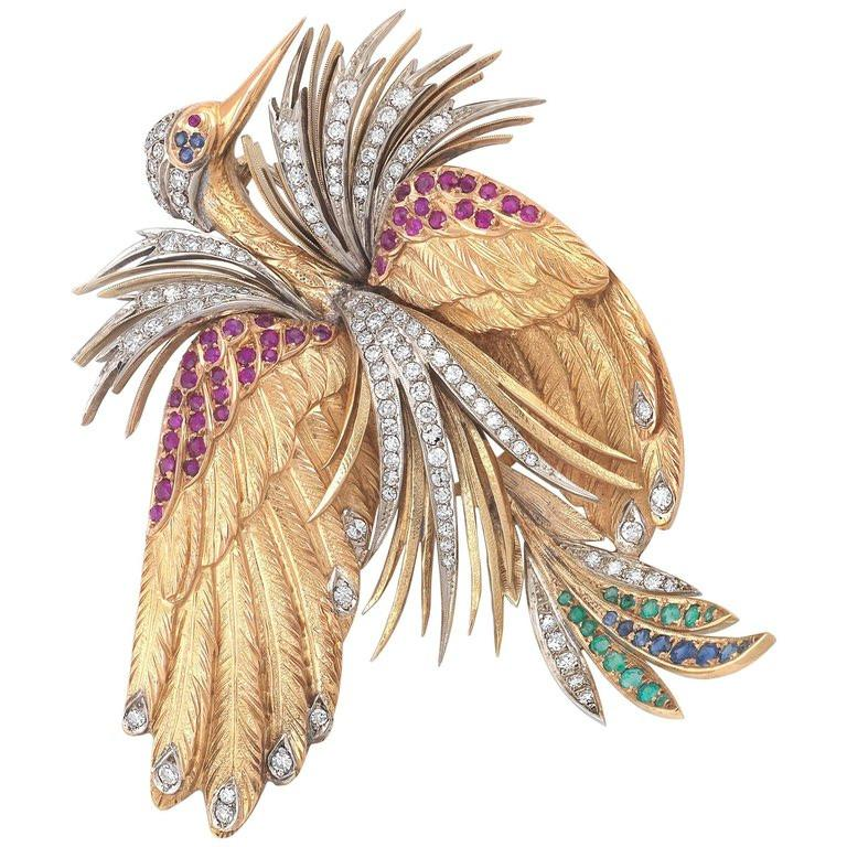 BERNARDO ANTICHITÀ PONTE VECCHIO FLORENCE  designed as a stork with rubies,emerald, sapphire and diamonds signed E. Serafini, Firenze; estimated total diamond weight: 1.5 carats; mounted in eighteen karat yellow gold; gross weight approximately: