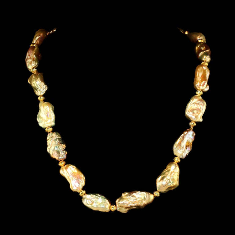 'Put on your Pearls Girls'  Lulu Guinness  When your tiara is in the bank, always wear your Pearls!  Gorgeous 20 inch white Baroque Pearl necklace to enhance your every look.  This Gemjunky necklace is a delight to wear.  It features longish