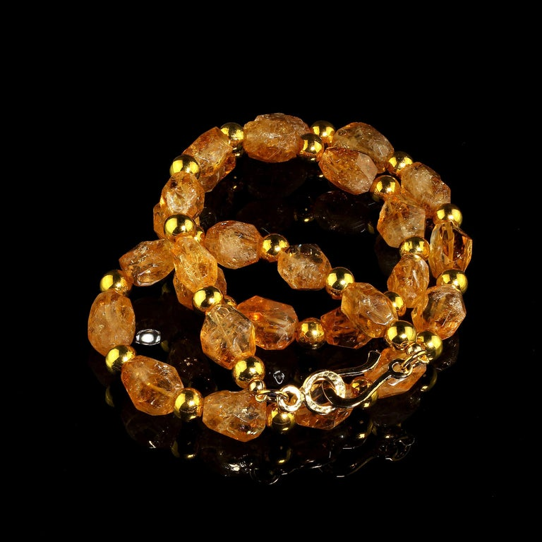 Fun and funky Gemjunky necklace of gorgeous golden faceted nuggets of Citrine with glistening goldy accents. These nuggets, which vary from transparent to translucent, are roughly faceted in approximately 14 X 11 MM pieces spaced with 8 MM accents.