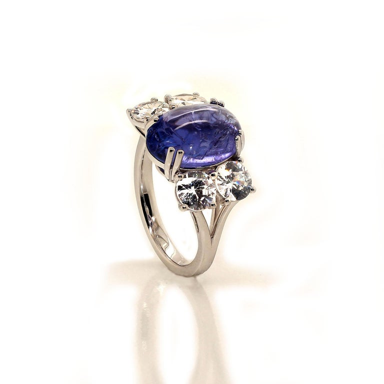 Artisan Dinner Ring of Cabochon Tanzanite and Sparkling Cambodian Zircons For Sale