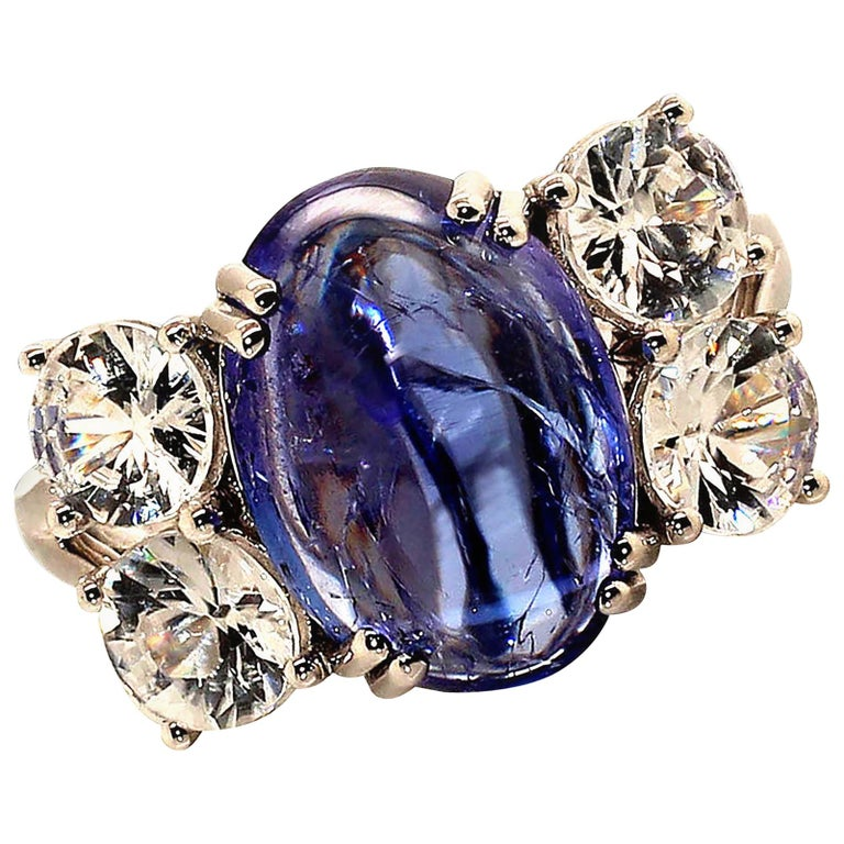 Dinner Ring of Cabochon Tanzanite and Sparkling Cambodian Zircons For Sale