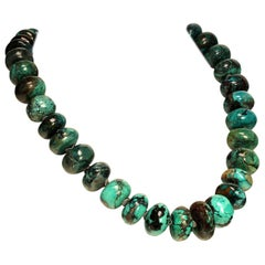Graduated Turquoise Rondelles with Silver Tone Flutters Necklace