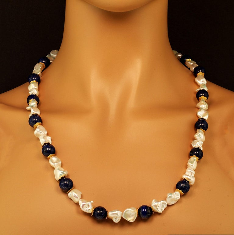 Own the jewelry you wish for  Custom made gorgeous white Keshi Pearl and Lapis Lazuli (12MM) Necklace with goldtone flutters for accents. These unique iridescent pearls flash yellow and pink from their gentle folds.  They are beautiful complements