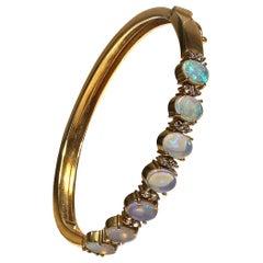 Opal, Diamond, and 18 Karat Yellow Gold Bracelet