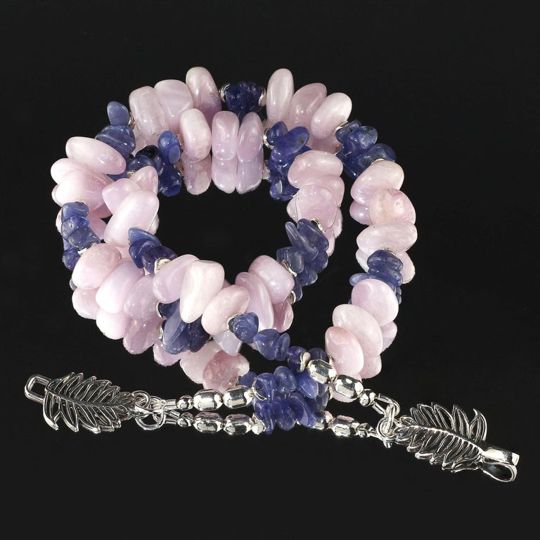 Handmade, unique necklace of glowing Kunzite nuggets and highly polished Tanzanite chips.  The pinky-mauve Kunzite plays off the purpley-blue Tanzanite to create a harmoniously elegant necklace.  Lovely silver flutters beautifully accent both