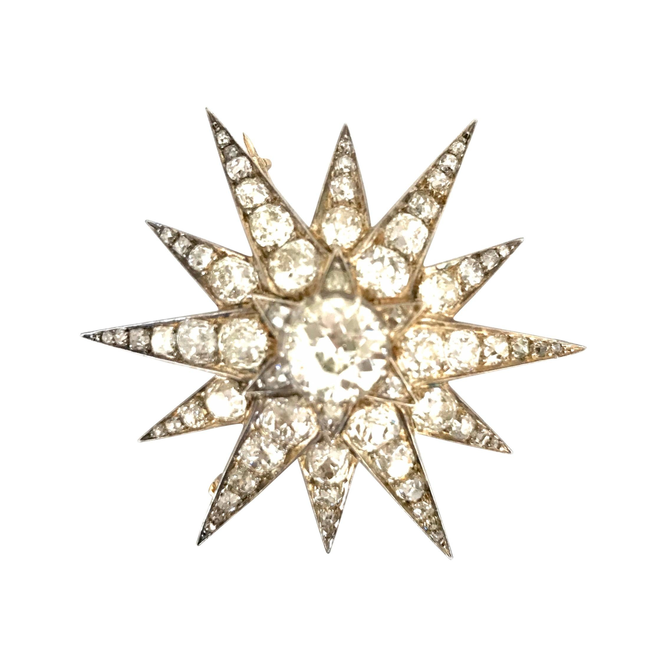 Gemolithos a Victorian Gold, Silver and Diamond Star Brooch/Pendant