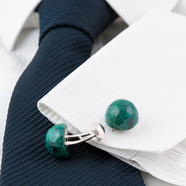 These statement cufflinks are designed and made in our Northern Irish workshop. These large one-of-a-kind blue-green Chrysocolla stones have been made into dome-shaped cabochon cufflinks - each stone having a weight of 24 carats and measuring 18 mm