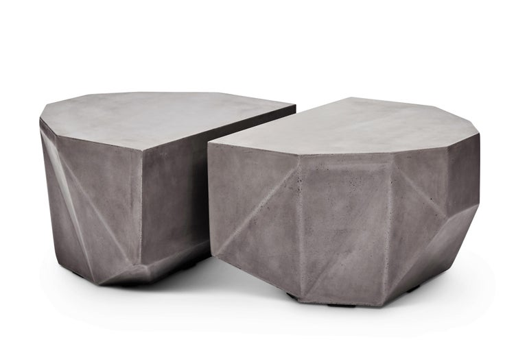 Resin reinforced natural concrete table featuring gem shaped twin tables that can be used separately or together in any pattern or pairing! Place the twin tables back-to-back to create a single monolithic surface, put them at opposite ends of a room