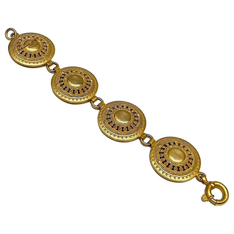 A wonderful ancient Etruscan inspired bracelet by Italian fashion house Genny circa 1990. The bracelet is comprised of four large 1.38 inch diameter pierced and bead work design lightly domed disks. They are attached by .32 of an inch small round