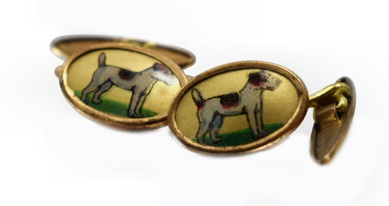 Fabulous pair of matching Art Deco men's cufflinks depicting the side profile of a Jack Russell dog. These charming cufflinks are ideal for the modern gentleman and animal lover. These cufflinks originate from England and are enamel decorated in a