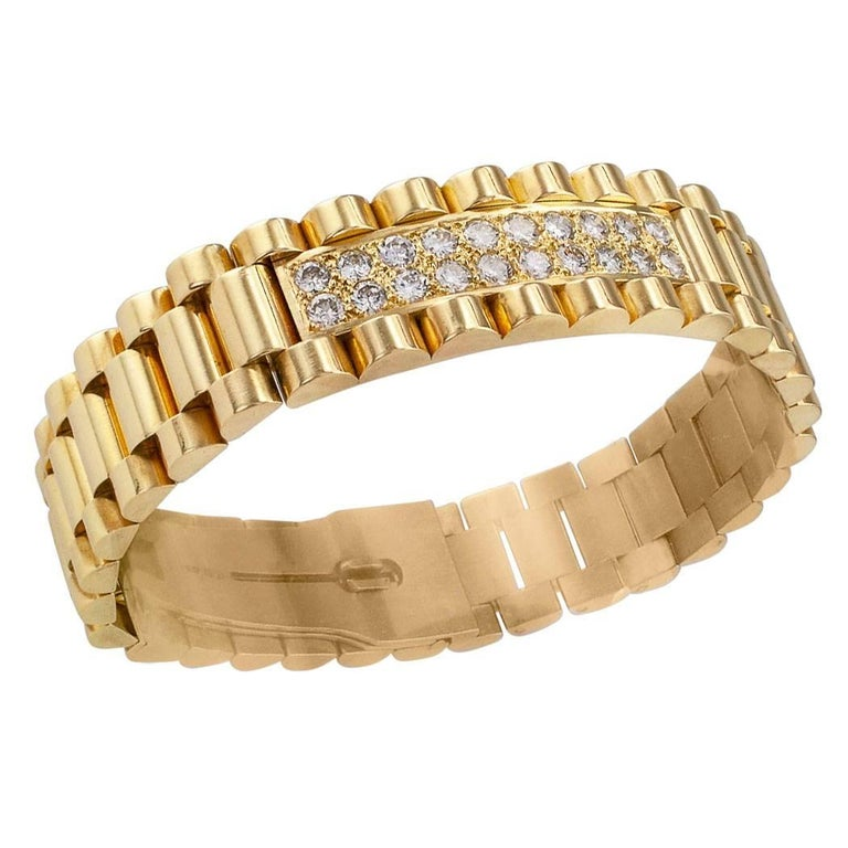Gentleman's diamond and gold link bracelet circa 1980. Crafted in 14-karat yellow gold, the bold and masculine design features a central plaque pavé-set with twenty-eight round brilliant-cut diamonds totaling approximately 2.40 carats, approximately