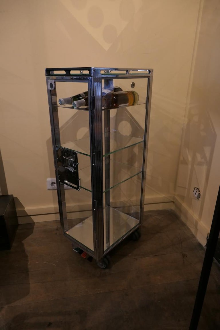 Genuine Aircraft vintage bar trolley completely transparent. Completely redone from head to toe with a magnificent transparent rendering. This original trolley has been completely boned. The work is substantial and requires many hours. The side