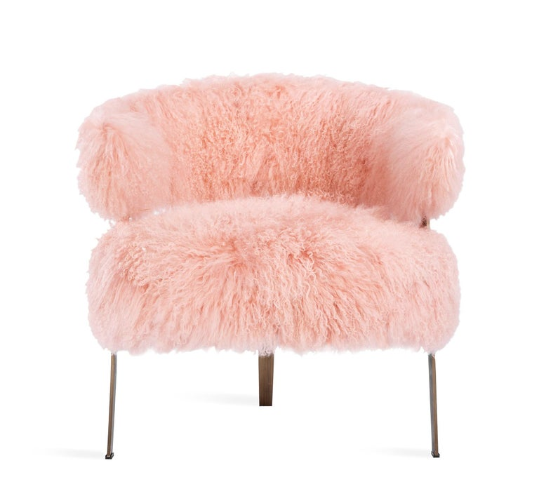 This playful lounge chair features a stainless steel frame in an antique bronze finish paired with a long curly premium-grade sheepskin seat in blush. 