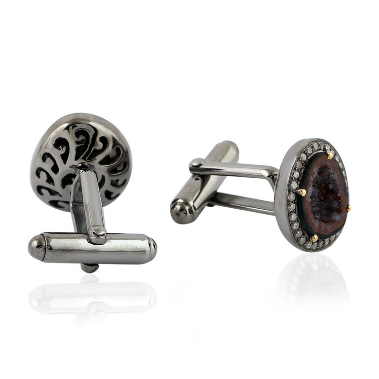 Cast from 18-karat gold and sterling silver, these cuff links are hand set with natural geodes and .50 carats of pave diamonds in black rhodium.  FOLLOW  MEGHNA JEWELS storefront to view the latest collection & exclusive pieces.  Meghna Jewels is