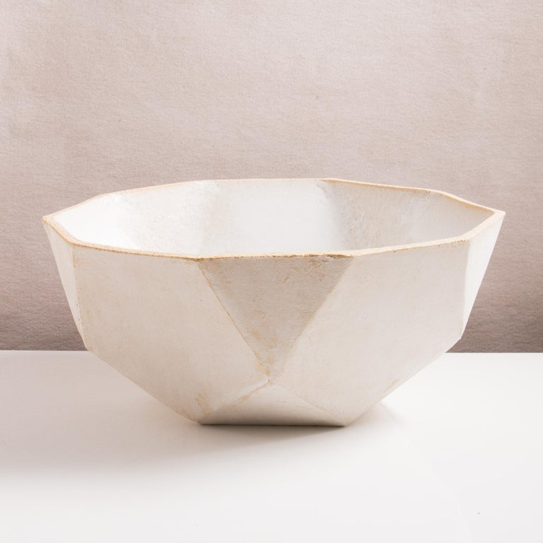 This dramatic ceramic bowl combines clean geometric lines with the warmth and individuality inherent in handmade work; it's the perfect statement for a coffee table or sideboard. Each bowl is assembled individually from flat sheets of a sandy