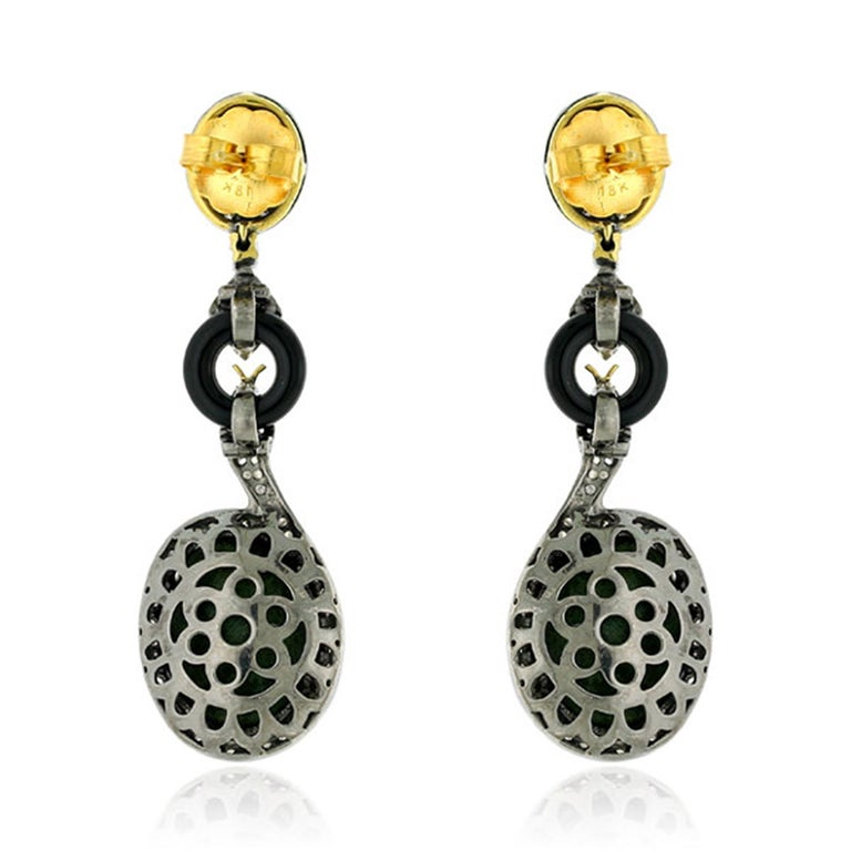 These handcrafted earrings are cast in 18-karat gold & sterling silver. It is set with geodes, 3.25 carats Kyanite, 3.2 carats onyx and 1.19 carats of sparkling diamonds.  FOLLOW  MEGHNA JEWELS storefront to view the latest collection & exclusive