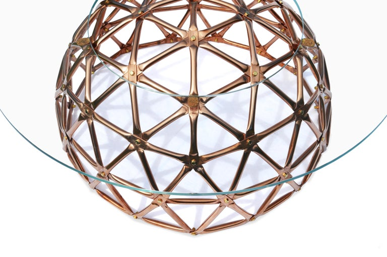 Inspired by the pioneering work of Buckminster fuller, the geodesic dome table brings the futuristic aesthetics and structural efficiency of geodesic architecture into furniture design. This unique center table provides a striking visual statement