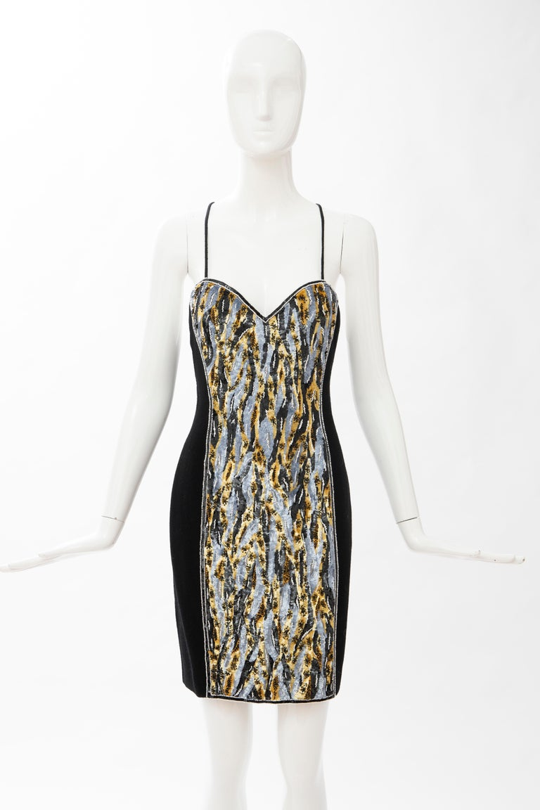 Geoffrey Beene, Circa: 1990's black wool crepe embroidered sequins dress ensemble.  The black wool crepe evening dress with embroidered white beads and black, gold, grey round sequins, back criss-cross spaghetti straps, silk interior front printed