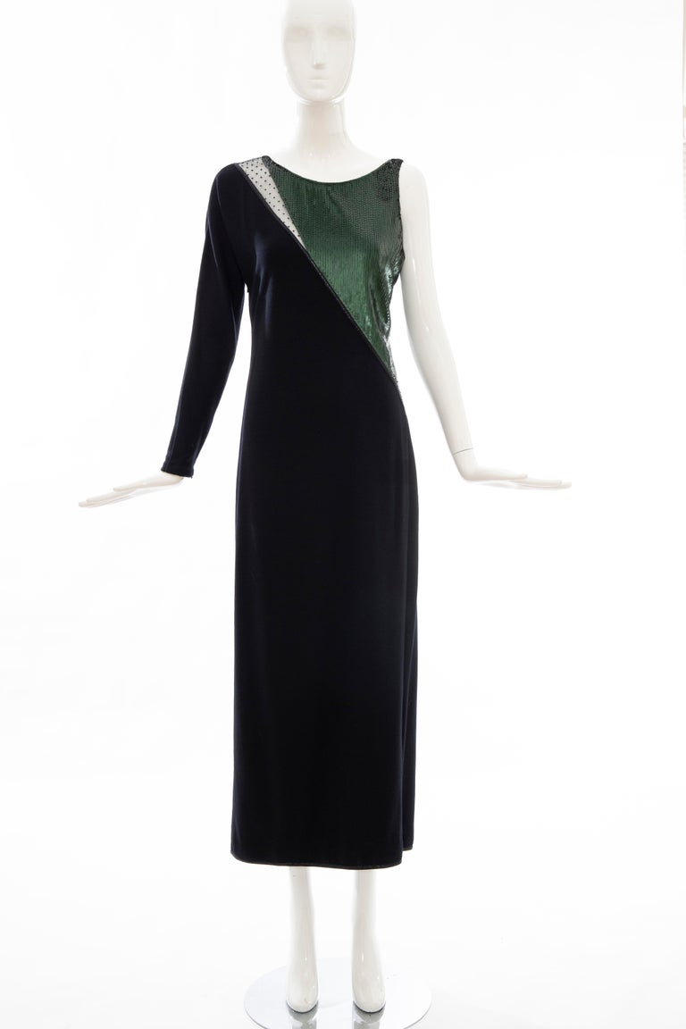 Geoffrey Beene, Fall 1991 black wool jersey evening dress, embroidered deep forest green sequins with point d' esprit lace inset, black metallic piping, interior front silk lining and side zip closure.  No Size Label  Bust: 33, Waist: 35, Hip: 40,