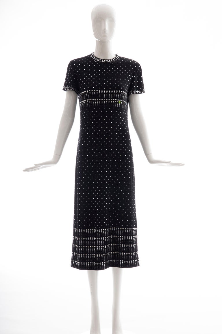 Geoffrey Beene, Fall 1966 black wool knit evening dress with appliquéd rhinestines, cap sleeve with back zip and hook-and-eye closure.  Archived at the Museum of Fine Art in Boston and the Museum at FIT.  US. 8 Bust: 33, Waist: 32, Hips: 40,