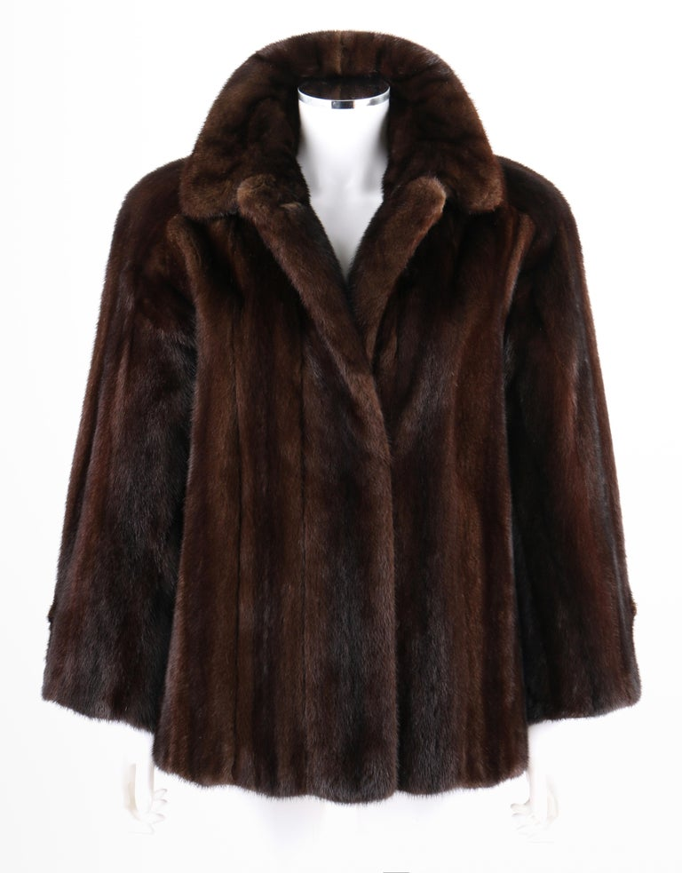 DESCRIPTION: GEOFFREY BEENE c.1980's Dark Brown Genuine Mink Fur Jacket Coat   Circa: c.1980's Label(s): Geoffrey Beene; Neiman Marcus  Designer: Geoffrey Beene Style: Jacket Color(s): Shades of brown Lined: Yes Unmarked Fabric Content (feel of):