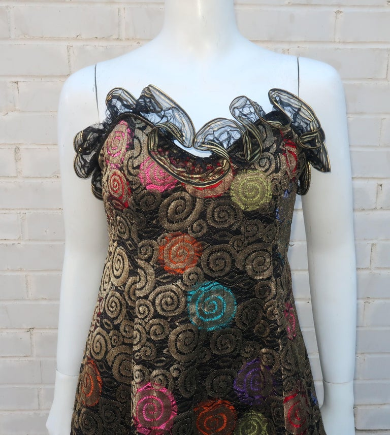 An amazing 1988 Geoffrey Beene strapless evening dress with a Gustav Klimt inspired fabric and a unique show-stopping silhouette.  The dress zips at the back with a built in boned corset and a train style hemline.  The fabric replicates Klimt's love