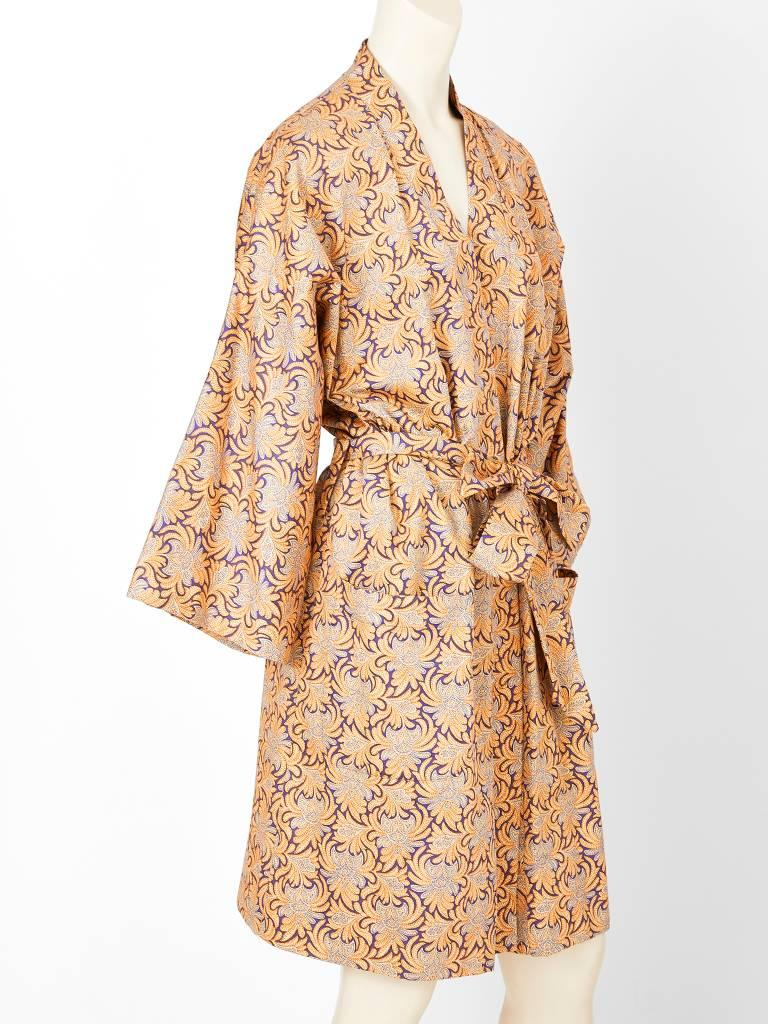 Geoffrey Beene, cotton, patterned, belted kimono having deep patch side pockets and a purple satin lining.