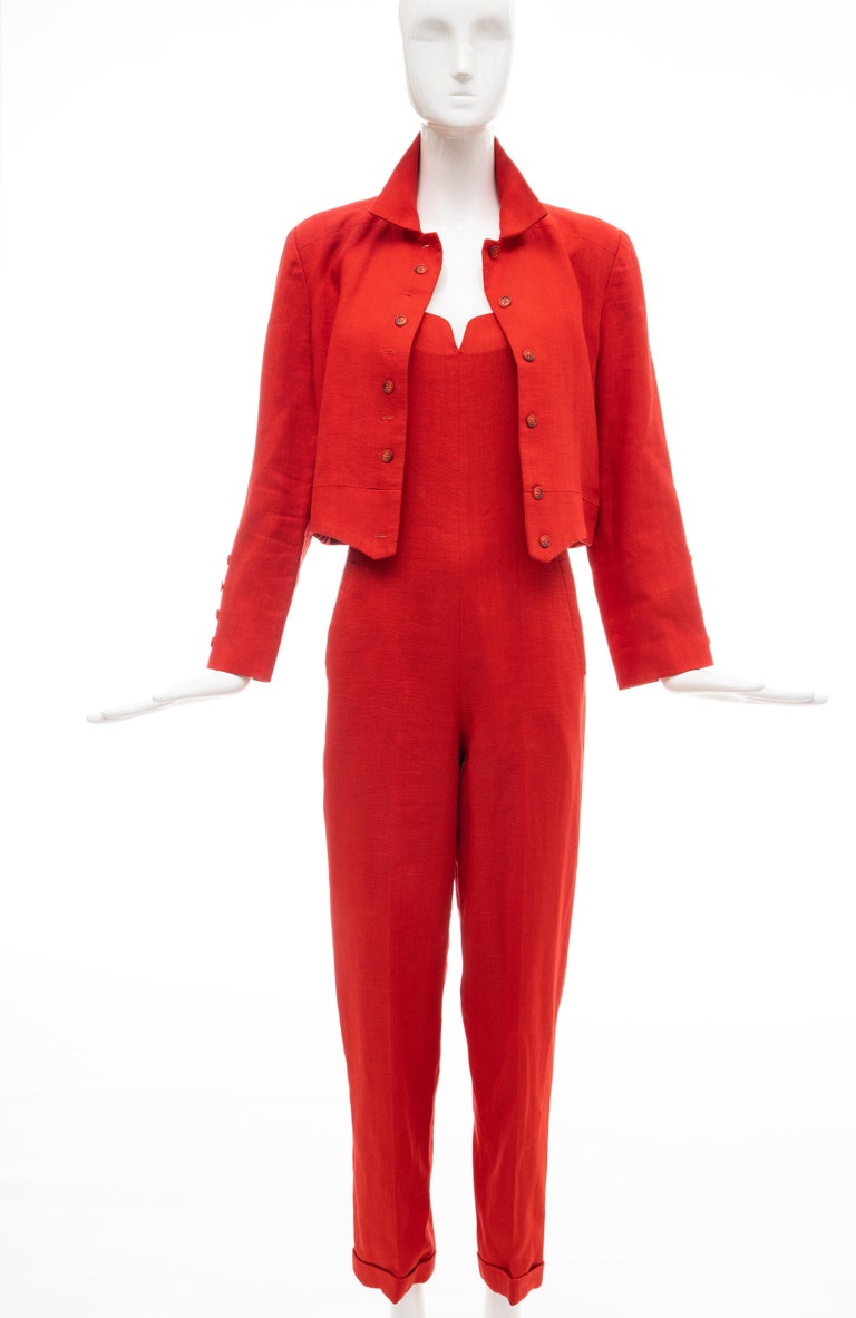 Geoffrey Beene, Circa:1970's red linen jumpsuit with two front pockets, back zip & hook-and-eye closure and fully lined in silk. Button front jacket fully lined in red silk with black polka dots.  US. 8 Jumpsuit: Bust: 33, Waist: 30, Hip: 38,